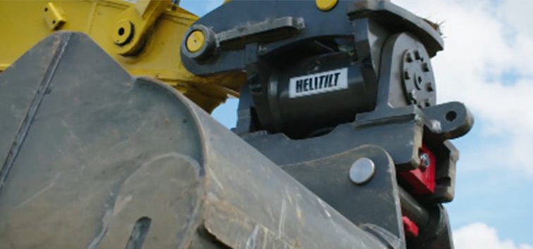 Heli-Tilt Quick Coupler on excavator wide